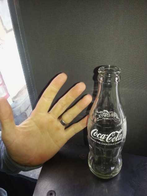 Lookit! Husband's breakfast Cola was so tiny Jana suggested we take a photo including his hand to show the scale. So cute he had two (Colas, not hands, he's always had two, and at R9 for the 200ml dinky bottle it's not bad).