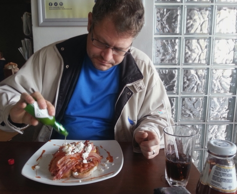 Husband went for the Hangover Eggs (not that he had one). It was very good, he loved them - slices of toast with baked beans, rashers of streaky bacon, egg and feta. Of course he doctored it with lots of Tabasco sauce. And washed it down with a Cola.