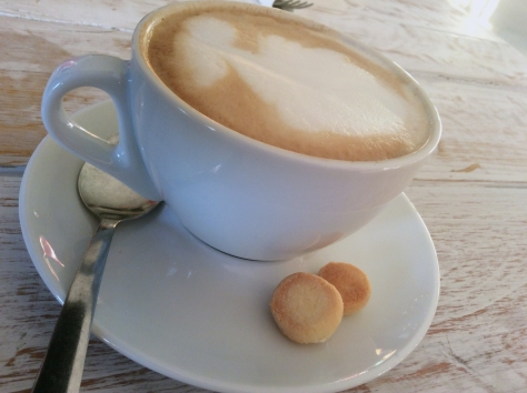 That's the outline of a lady in my cappuccino foam, and two homemade shortbread rounds in my saucer. Win win.