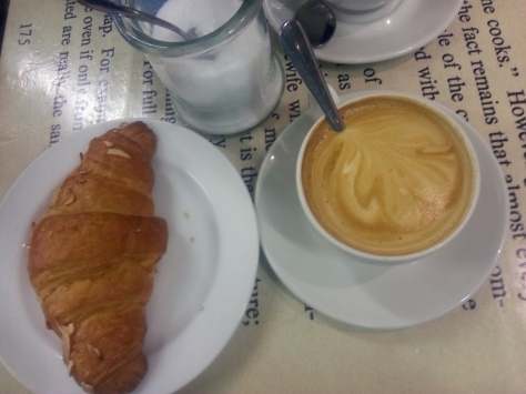 My almond paste-filled croissant and stirred cappuccino. Yummy!