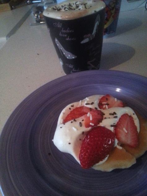 Milo with sprinkles! Flapjacks with whipped cream and strawberries! Mmm.