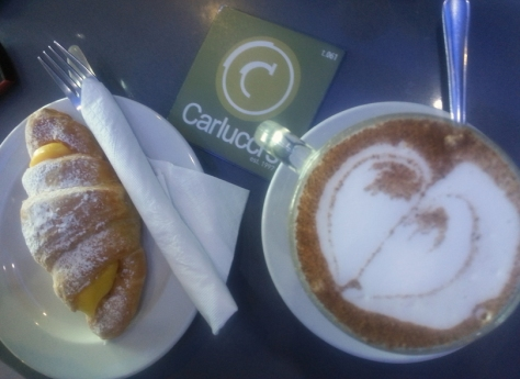 Chai latte and custart croissant at Carluccis, Blouberg
