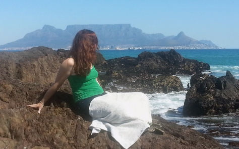 Leigh sitting on rocks at Blouberg beach