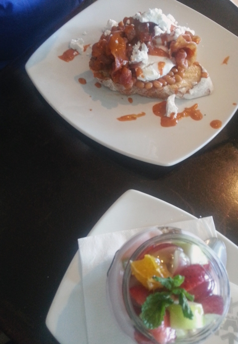 A muesli jar and eggs and beans on toast for breakfast at News Cafe, Blouberg