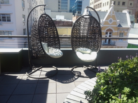 Egg chairs on Inner City Ideas Cartel rooftop