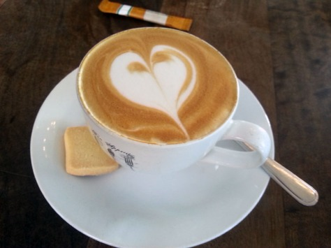 A cappuccino with shortbread biscuit at Bread & Butter