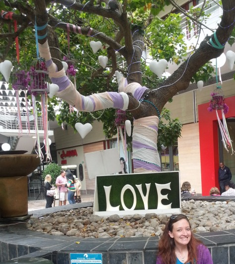 Tree wrapped in ribbon and hearts