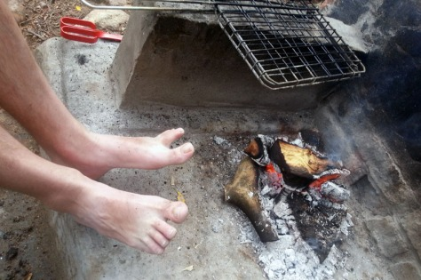 Heating toes on braai