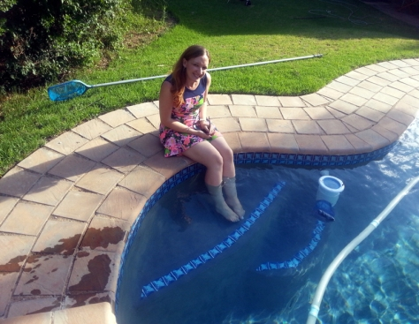 Dipping feet in pool