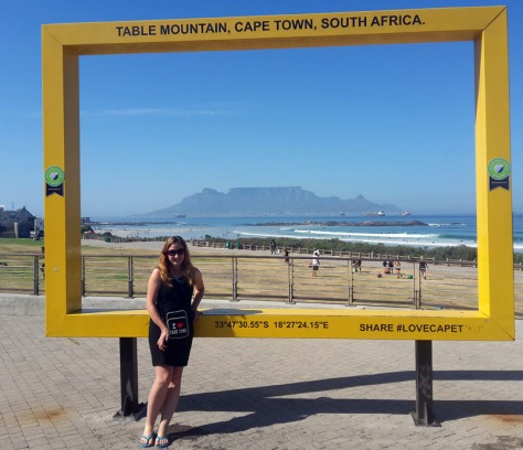 Posing at yellow National Geographic Table Mountain frame